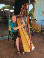 Hna Anderson with a Paraguayan harp